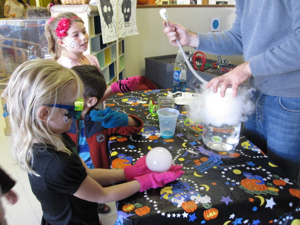 LCM Children are learning how to create bubbles that you can hold through scientific methods during Fall Fest